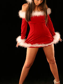 Look at this freckle faced little teen Kari Sweets, she is dressed up in a sexy Santa dress and making her Mom proud, sucking on a candy cane like a g